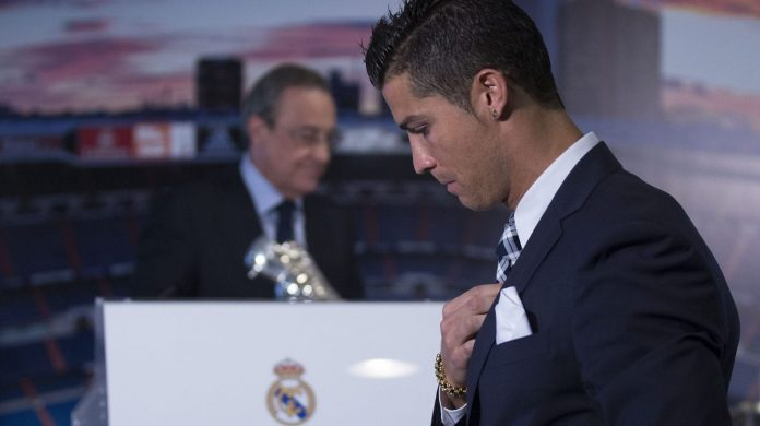 MADRID, SPAIN - OCTOBER 02:  Cristiano Ronaldo walks to the tribune ahead president Florentino Perez before receiving his trophy as all-time top scorer of Real Madrid CF at Honour box-seat of Santiago Bernabeu  Stadium on October 2, 2015 in Madrid, Spain. Portuguese palyer Cristiano Ronaldo overtook on his last UEFA Champions League match against Malmo FF Raul's record as Real Madrid all-time top scorer.  (Photo by Gonzalo Arroyo Moreno/Getty Images)
